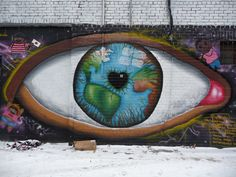 Toronto Street Art... See how the earth's map is captured in the eyeball...