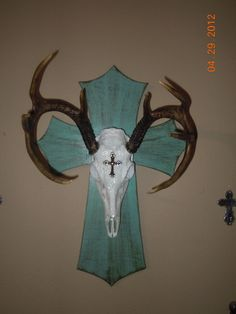 I decided that my deer needed a little bling. It just didn't have enough sparkle! So, I added some... and slapped it on a cross I painted. Much better!!