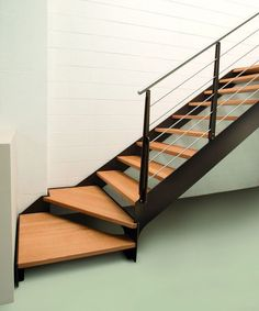 Floating staircases are the new thing with this trendy design of winder stairs. Wood meets metal with this one-of-a-kind beauty. Steel Stairs Design, Stair Railing Design, Stair Handrail, Railings, Loft Stairs, House Stairs, Winder Stairs, Door Gate Design, Modern Stairs
