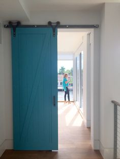 carpentry details. Millwork . Teal barn door. Contemporary carpentry . Pops of color .