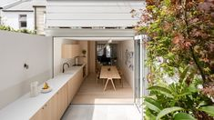 This Pinterest board includes an Ilse Crawford-designed community kitchen and a renovated Sydney terrace with a kitchen counter that extends to the garden.