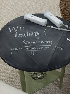 chaulk board side table. Fun for family room. I have a side table I could do this with! Basement entertainment