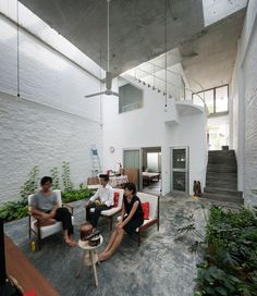 Living area in the indoor courtyard with beautiful cement rendered flooring