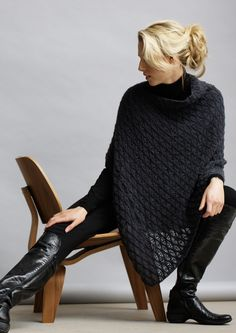 This poncho is made from a simple rectangle, folded and sewn along one edge, with a gap remaining at one side for neck opening.