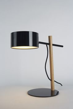 Rich Brilliant Willing's Excel Desk Lamp. I'm digging their gloss black + natural oak dowel aesthetic.