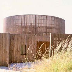 A crematorium in Rennes, France, featuring a series of circular structures surrounded by a ring of granite blocks.
