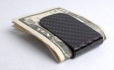 Low-profile, lightweight front-pocket money clip made from high-quality carbon fiber infused with epoxy resin.