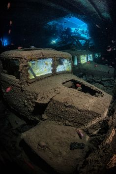The famous wreck of the Thistlegorm in the Red Sea. The cargo of the ship holds many cars and bikes. These trucks are on the lower decks of the cargo holds. Underwater Shipwreck, Underwater Ruins, Underwater Pictures, Underwater World, Abandoned Ships, Abandoned Cars, Abandoned Buildings, Abandoned Places, Pompe A Essence