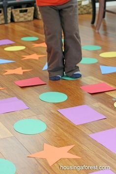 Shape hopscotch - Indoor Games for Kids: The school has vinyl shapes that could be used for this game. Maybe make dice to use with this to have students roll to know where to jump.