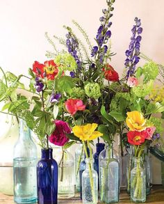 spring decor. Idea for what to do with all my glass bottles and vases