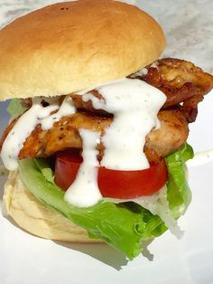 Blackened Chicken Sandwich with Lettuce, Tomato and Yogurt Ranch Dressing recipe -Tender juicy blackened chicken, cold crisp lettuce, plump red ripe tomatoes and tangy yogurt ranch dressing all on a squishy soft, slightly sweet potato roll. Delicious. - theoptimalistkitchen.com