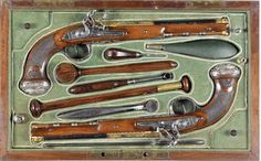 A Very Fine Cased Pair Of French Silver-Mounted Flintlock Pistols Of Presentation Quality