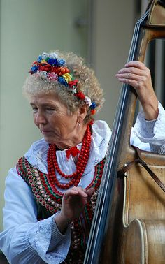 Lady playing traditional polish music in Krakow, Poland