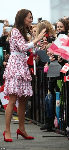 The Duchess of Cambridge profile or side view of red and white print dress, red shoes and clutch purse. Canadian flag.