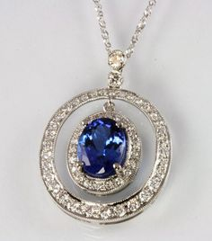 White gold oval tanzanite pendant with diamonds. #tanzanite #necklace