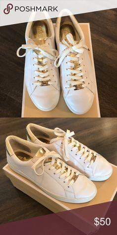 a9beb374b1d Michael Kors White Sneakers. Gently worn white and gold sneakers. MICHAEL  Michael Kors Shoes