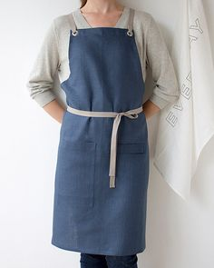 This Kitchen Apron in a luscious dark slate-blue linen. Its elegant, but thoroughly tested and approved for durability. Comfortable straps fit to your body and eliminate any strain on your neck. 100% linen, finished with sturdy nickel-plated grommets and slate gray cotton twill straps. 35 long x 30 wide. One size fits all.