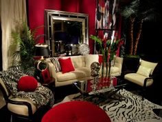 Zebra prints & red walls......definitely my kinda room! by: designindulgences.com