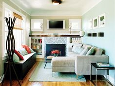 sofa with chaise section in a tiny living room. maybe this is possible in our cottage?