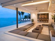 Beach house inspiration: sunken seated area with cushions.