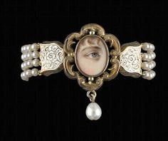 Bracelet surmounted with miniature in gold surround with drop pear & restrung with four strands of cultured pearls via(from the private collection of David and Nan Skier)