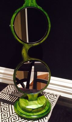 Spinning magnifying mirror we made for an optical shop in Minnesota. Www.backyardspectacles.com