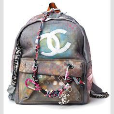 Chanel's canvas graffiti backpack -- finally, this belongs to me. For real own it.
