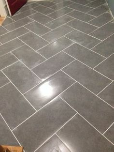 mitte gray glazed porcelain floor tile x we put this in one of our bathrooms with bright white grout we used a different pattern thou and everyone is - Tile Floors