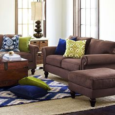 Merveilleux Brown Couch   Blue Accent Pillows   Lamp   Rug   Living Room
