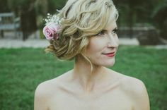 Loose and low updo with flowers | Jessica Fey Photography
