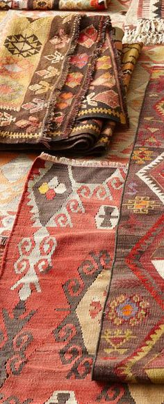 Vintage kilim rugs add a beautiful depth of interest to a room. If only they could talk about the many feet that have traversed upon them!