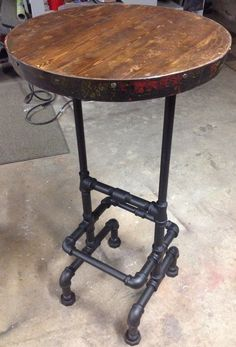 Industrial Pub Table Round Bar Metal And Wood Dining Tables 16 Plumbing Pipe Furniture, Industrial Furniture, Wood Furniture, Industrial Pipe, Steampunk Furniture, Furniture Outlet, Discount Furniture, Furniture Projects, Furniture Making