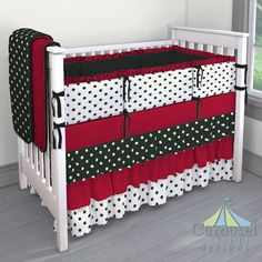 Crib bedding in Black and White Polka Dot, Solid Red, White and Black Polka Dot, Solid Black Minky, Solid Black. Created using the Nursery Designer® by Carousel Designs where you mix and match from hundreds of fabrics to create your own unique baby bedding. #carouseldesigns