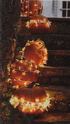 No Carve Pumpkin ~ Miniature white lights wound around the outside of  the pumpkin / Woman's Day