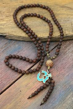 Mala made of 108, 8 mm - 0.315 inch, beautiful frosted Tibetan style agate gemstones and decorated with a handmade Nepalese OM pendant. The guru bead is a handmade Nepalese bead - look4treasures on Etsy