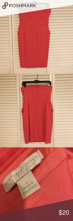 Coral strapless dress Strapless, pique stretch material dress. Coral color, with 2 pockets by New York & Co. Worn once, in great shape. New York & Company Dresses Strapless