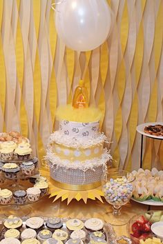 Yellow and grey You Are My Sunshine Baby Shower Diaper Cake. Sweet Table decor.