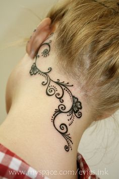 Good way to bring the ear tattoo into a spinal tattoo. The spirals are nice, it reminds me of my doodles. Cute.