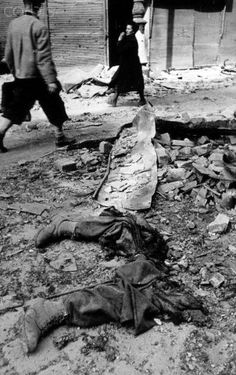 World War II - Vienna 1945 - 42-26082633 - Rights Managed - Stock Photo - Corbis. The cruelty of World War II in April 1945: After heavy fights in the streets of Vienna civilians walk past cut off limbs of a German soldier. Photo:Yevgeny Khaldei