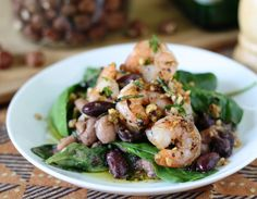 """Beans & arugula topped with garlic-hazelnut-crusted shrimps, as featured in the 18sep13 issue of """"Everyday Mediterranean."""" For info & subscriptions: http://nutrelan.com/everyday-mediterranean-meal-plan-how-it-works/."""