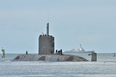 The Royal Canadian Navy submarine HMCS Victoria (SSK 876) departs Joint Base Pearl Harbor-Hickam for the at-sea phase of Exercise Rim of the Pacific (RIMPAC) on July 7, 2014.