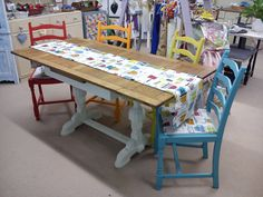 Multicolour chair and table set, influenced by the retro style fabric.