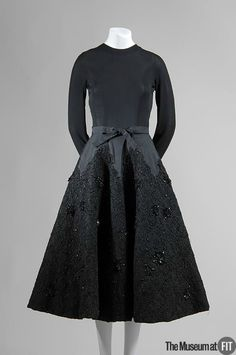 Cristobal Balenciaga (French, founded 1949), Evening dress, 1951-52. Black silk jersey, silk faille, and sequin and jet beaded lace. Gift of Noma Copley. 84.114.5. The Museum at FIT 2012 © The Museum at FIT.