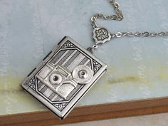silver locket necklace The OLD PHOTO ALBUM by plasticouture, $26.50