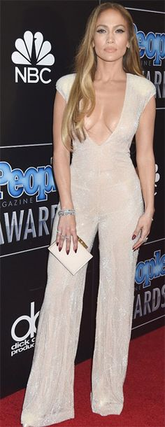 Jennifer Lopez oozes her glamorous look  Jennifer Lopez wore a dress where she oozes in her glamorous look. She is worth almost $400 million. But Jennifer Lopez still seems interested in making as much money as she   possibly can. On Tuesday Life & Style reported the 45-year-old performer snapped up $1.75 million for a 40 minute private concert in Macau in November. The Boy Next Door   actress. Check her out  at:http://womenfitness.net/news/other/jenniferLopez_glamorous.htm