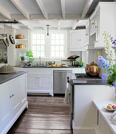 From its exposed joists to uneven, wide-plank floors, the bright, updated kitchen in this Connecticut farmhouse still retains much of its historic charm.   - Delish.com