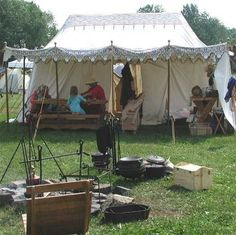 "Embarking on a ""Period"" Medieval Encampment - Elizabeth Jones. FANTASTIC blog on everything from inspiration, examples, finances, time, transportation and storage, setup/takedown, ground coverings, awnings, painting and stenciling, banners, wind walls, all the stuff inside the tent, room dividers, lighting, furniture, kitchen setup, cooking, and all the different shapes and styles."