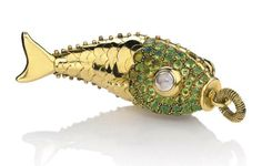 A PERIDOT, CITRINE, MOONSTONE AND GOLD 'FISH' PENDANT, BY RENÉ BOIVIN