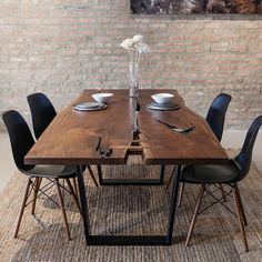 Single-slab walnut dining table. This piece features beautiful natural voids, large butterfly joints, and is paired with our most popular trapezoid base. Better yet, it's on sale! Visit our website to shop a handful of stunning pieces also included in our end of year sale, link in profile.