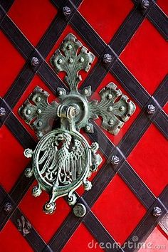 Ancient Door Knocker- I pinned this to this board because I think the door decoration would make a great wall treatment. Maybe mixed with the red blocks it could be plaid blocks, too!!